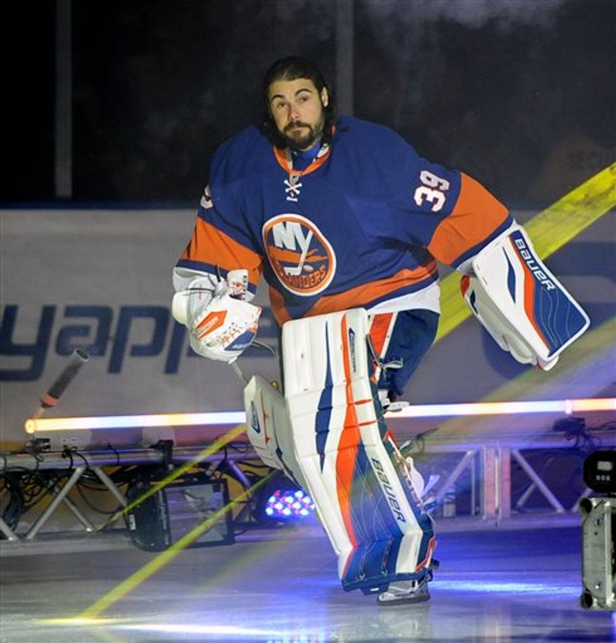 FILE - In this Jan. 19, 2013 file photo, New York Islanders goalie Rick DiPietro skates onto the ice during team introductions before the start of the home opener of an NHL hockey game against the New Jersey Devils in Uniondale, N.Y. DiPietro is now a former Islanders goalie after he cleared waivers and had his long contract bought out by the team. The Islanders used a compliance buyout Wednesday, July 3, 2013, to remove the final eight years of the goalie's deal from the club's salary cap. (AP Photo/Kathy Kmonicek, File)