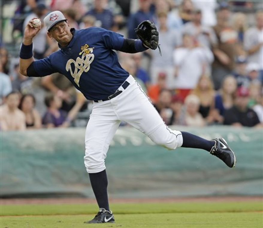 New York Yankees' Alex Rodriguez tries to throw to first base during the inning in his first rehab game with the Charleston RiverDogs against the Rome Braves in Charleston, S.C., Tuesday, July 2, 2013. (AP Photo/Chuck Burton)