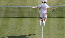 Bob Bryan and Mike Bryan of the United States chest bump after defeating Rohan Bopanna of India and Edouard Roger-Vasselin of France in their Men's doubles semifinal match at the All England Lawn Tennis Championships in Wimbledon, London, Thursday, July 4, 2013. (AP Photo/Alastair Grant)