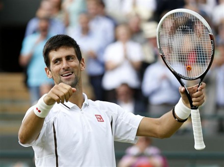 Novak Djokovic of Serbia reacts after beating Tomas Berdych of the Czech Republic in a Men's singles quarterfinal match at the All England Lawn Tennis Championships in Wimbledon, London, Wednesday, July 3, 2013.(AP Photo/Sang Tan)