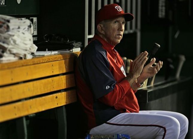 Washington Nationals manager Davey Johnson is seen in the dugout before the start of the fourth inning in a baseball game against the Arizona Diamondbacks at Nationals Park, Wednesday, June 26, 2013, in Washington. (AP Photo/Pablo Martinez Monsivais)