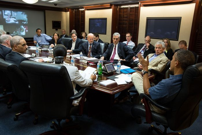 President Obama convenes a meeting with his national security team at the White House, Thursday, July 4, 2013. (Credit/Pete Souza)