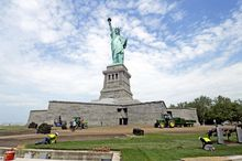 In this June 26, 2013, photo provided by the National Park Service, workers on Liberty Island install sod around the national monument, which is set to re-open on the Fourth of July, in New York. (AP Photo/National Park Service)