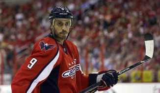 **FILE** Washington Capitals center Mike Ribeiro pauses in the first period of Game 5 of the Capitals' first-round playoff series against the New York Rangers on May 10, 2013 in Washington. (Associated Press)