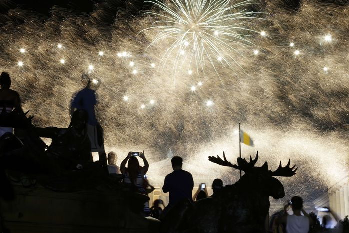 Fireworks explode over the Philadelphia Museum of Art during an Independence Day celebration, Thursday, July 4, 2013, in Philadelphia. (AP Photo/Matt Rourke)