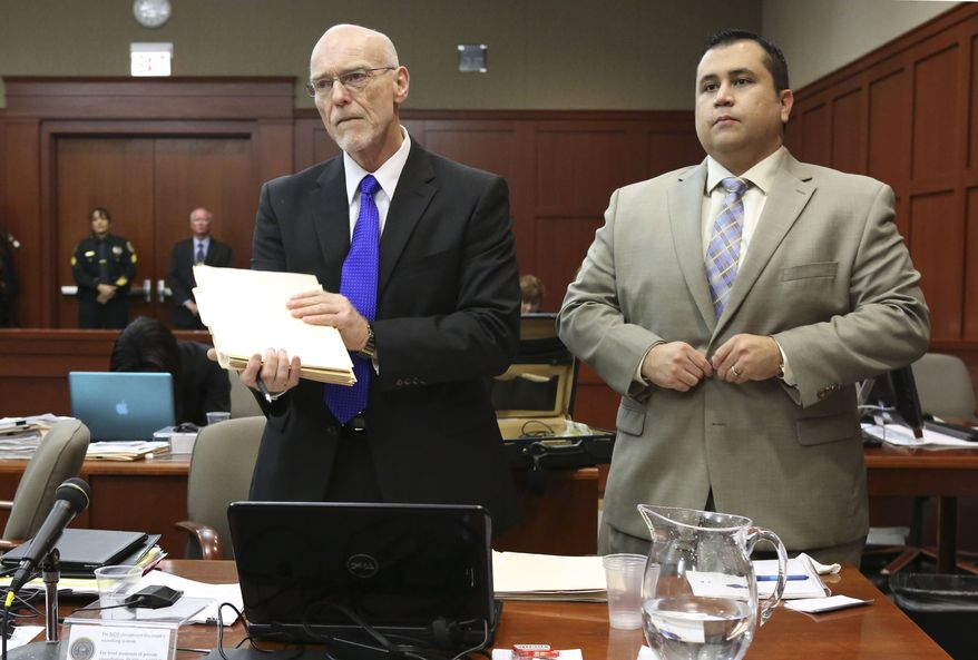George Zimmerman (right) stands next to Don West, one of his defense attorneys, during his trial in Seminole circuit court in Sanford, Fla., on July 5, 2013. Zimmerman has been charged with second-degree murder for the 2012 shooting death of Trayvon Martin. (Associated Press/Orlando Sentinel)