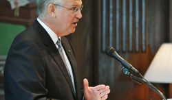 ** FILE ** Gov. Jay Nixon speaking at a news conference Friday, June 28, 2013, in his Missouri Capitol office in Jefferson City. (AP Photo/The Jefferson City News-Tribune, Julie Smith)