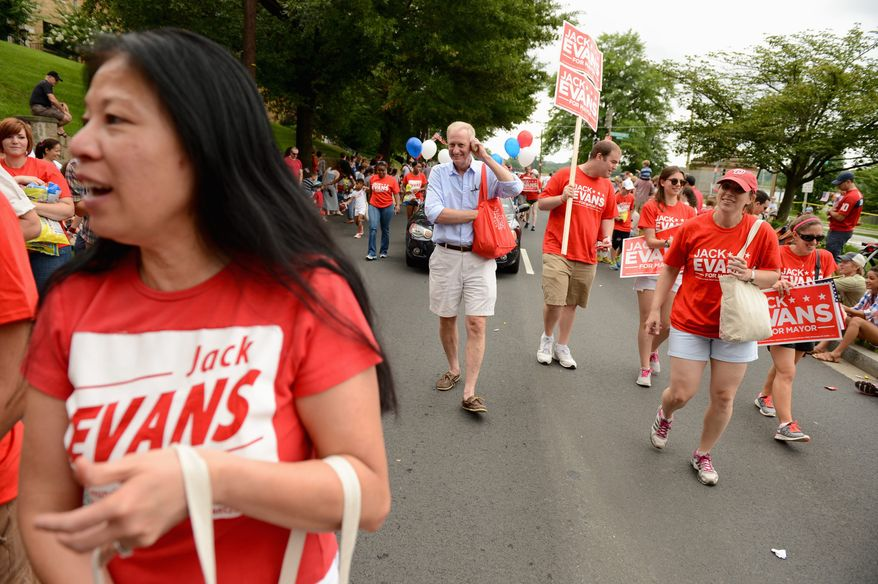 D.C. Council member Jack Evans, Ward 2 Democrat, walks with supporters in the Palisades July Fourth parade. Mr. Evans was one of three mayoral candidates in addition to the sitting mayor, Vincent C. Gray, to participate this year. (Andrew Harnik/The Washington Times)