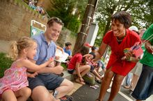 D.C. City Council member Muriel Bowser, Ward 4 Democrat and mayoral candidate, joined the Fourth of July party on the Palisades parade route on MacArthur Boulevard. (Andrew Harnik/The Washington Times)