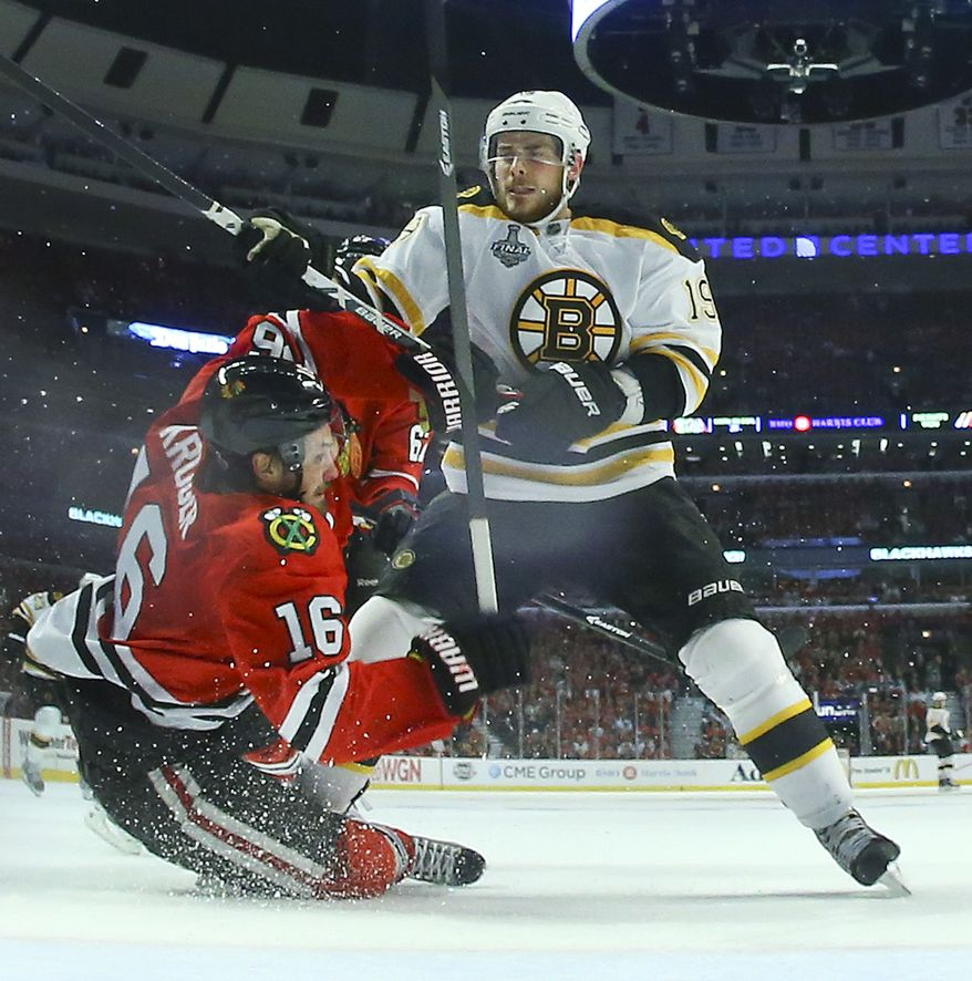 Boston Bruins center Tyler Seguin (19) collides with Chicago Blackhawks center Marcus Kruger in the third period of Game 5 of the Stanley Cup Finals in Chicago on June 22, 2013. (Associated Press)