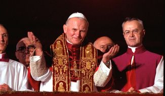 ** FILE ** In this Oct. 22, 1978, file photo, Pope John Paul II blesses the faithful in St. Peter's Square from a Vatican City balcony right after he was named pontiff. A Vatican official says Pope John Paul II has cleared the final obstacle before being made a saint. (AP Photo)
