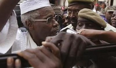 ** FILE ** Former Chad dictator Hissene Habre, left, is seen as he leaves the court in Dakar, Senegal, Nov. 25, 2005. For more than 20 years, former Chadian dictator Hissene Habre lived a life of luxurious exile in Senegal, taking a second wife and watching 'Seinfeld' shows. On Tuesday, July 2, 2013, judges at a special court in Dakar formally charged Habre with crimes against humanity, war crimes and torture. (Associated Press)