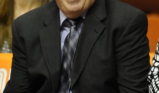 Washington Mystics coach Mike Thibault smiles before a WNBA basketball game against the Connecticut Sun in Uncasville, Conn., Friday, June 7, 2013. (AP Photo/Jessica Hill)