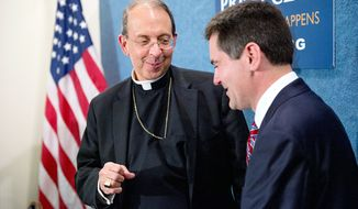 "Baltimore Archbishop William E. Lori (left) and Southern Baptist Ethics and Religious Liberty Commission President Russell Moore speak together last week following a news conference at the National Press Club. More than 100 national religious leaders in an open letter are asking the Obama administration to ""expand conscience protections"" in the Affordable Care Act's employer mandate. Critics say it does not go far enough in divorcing the institutions from health plans that cover contraception. (Andrew Harnik/The Washington Times)"