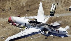 The wreckage of an Asiana Airlines Boeing 777 is pictured after it crashed while landing at the San Francisco International Airport in San Francisco on Saturday, July 6, 2013. (AP Photo/Marcio Jose Sanchez)