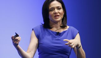 Facebook Chief Operating Officer Sheryl Sandberg delivers a speech during the Global Women's Leadership Summit in Tokyo on Tuesday, July 2, 2013. (AP Photo/Shizuo Kambayashi)