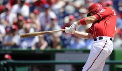 Washington Nationals' Ryan Zimmerman follows through on his grand slam against the San Diego Padres during the third inning of a baseball game on Sunday, July 7, 2013, in Washington. (AP Photo/Nick Wass)