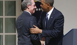 **FILE** President Obama shakes hands with Michael Froman, his nominee for U.S. Trade Representative, during a Rose Garden ceremony at the White House on May 2, 2013. (Associated Press)