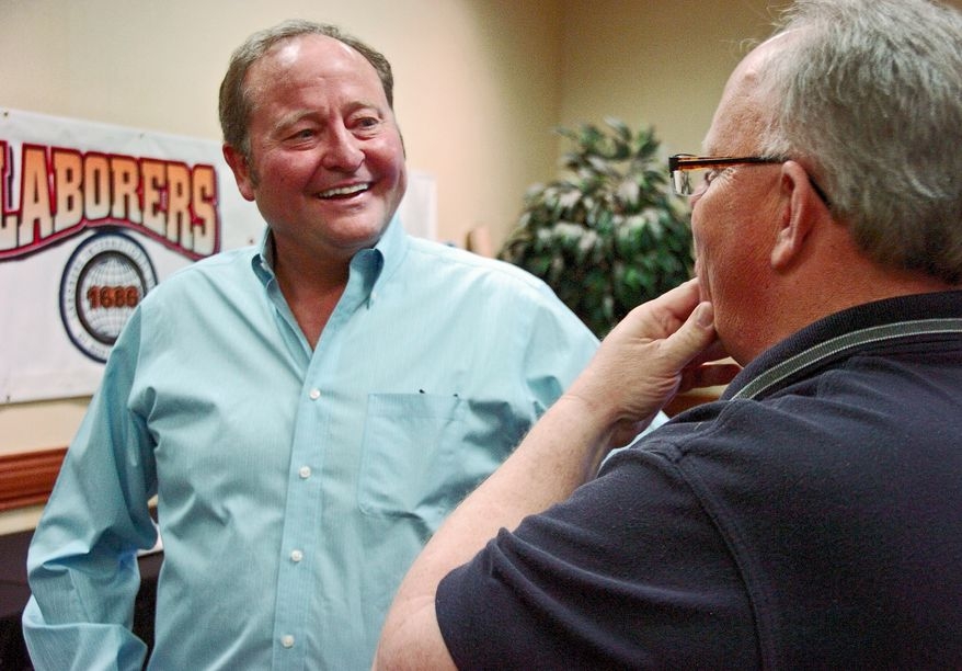 **FILE** Former Montana Gov. Brian Schweitzer (left) speaks with union representatives at the Montana AFL-CIO annual convention in Billings, Mont., on May 10, 2013. Schweitzer, who was endorsed by the AFL-CIO during his two gubernatorial campaigns, is considering a run for the U.S. Senate. (Associated Press)