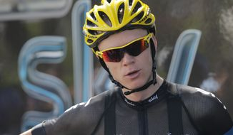 Overall leader Christopher Froome of Britain prepares to leave for a training ride with his teammates on the rest day of the Tour de France cycling race in La Baule, western France, Monday July 8 2013. (AP Photo/Laurent Cipriani)