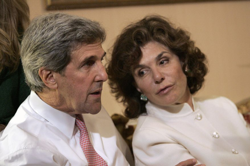 In a Tuesday, Nov. 4, 2008, file photo, Sen. John Kerry, D-Mass, left, talks with his wife Teresa Heinz Kerry while watching election results at a hotel in Boston, in Boston. (AP Photo/Michael Dwyer, File)