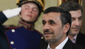 Iranian President Mahmoud Ahmadinejad arrives for a meeting with Russian President Vladimir Putin in the Kremlin in Moscow, Tuesday, July 2, 2013. (AP Photo/Maxim Shemetov, Pool)