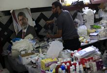 An Egyptian medic supporter of ousted President Mohammed Morsi, works at a field hospital in Nassr City in Cairo, Egypt, Monday, July 8, 2013. Egyptian soldiers and police opened fire on supporters of the ousted president early Monday in violence that left dozens of people killed, including one officer, outside a military building in Cairo where demonstrators had been holding a sit-in, government officials and witnesses said. (AP Photo/Khalil Hamra)