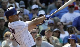 Chicago Cubs' Scott Hairston hits a two-run home run during the second inning of a baseball game against the Pittsburgh Pirates in Chicago, Friday, July 5, 2013. (AP Photo/Nam Y. Huh)