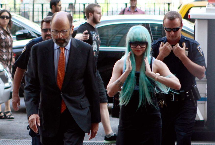 Amanda Bynes, accompanied by attorney Gerald Shargel, arrives for a court appearance in New York, Tuesday, July 9, 2013. The 27-year-old actress is charged with reckless endangerment and attempted tampering with physical evidence. Bynes was arrested in May after building officials called police to complain she was smoking pot in the lobby. (AP Photo/Bethan McKernan)