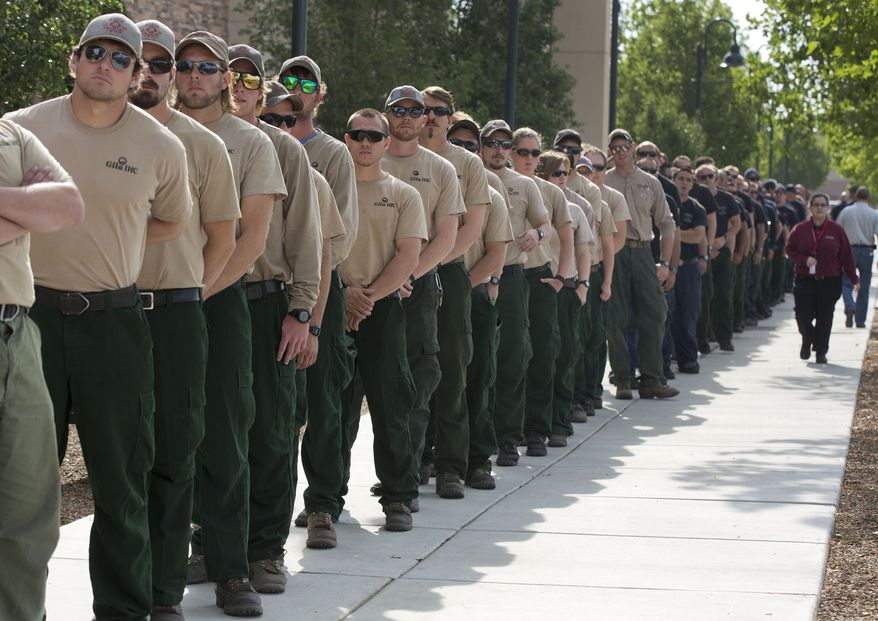 The Gila Interagency Hot Shot Crew from New Mexico lines up outside Tim's Toyota Center along with Hotshot crews from other states on July 9, 2013 in Prescott, Ariz. Thousands of firefighters gathered at the center along with Vice President Joseph R. Biden and other dignitaries and family members of the 19 fallen Granite Mountain Hotshots for a memorial service honoring the 19 who were killed battling a blaze near Yarnell, Ariz. last week. (Associated Press)
