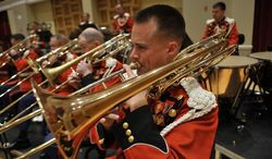 """The U.S. Marine Corps band celebrates its 215th birthday this week. It is proud of its nickname, """"The President's Own."""" (United States Marine Band)"""