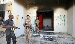 **FILE** The Sept. 11 attack on the U.S. diplomatic post in Benghazi, Libya, killed Ambassador J. Christopher Stevens and three other Americans. Security specialists say with diplomats residing in more well-guarded parts of cities, intelligence is likely to decline. (Associated Press)
