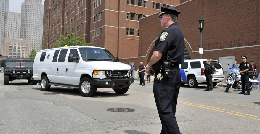A U.S. Marshal's van, believed to be carrying Boston Marathon bombing suspect Dzhokhar Tsarnaev, arrives at the federal courthouse for his arraignment on July 10, 2013, in Boston. The April 15 attack killed three and wounded more than 260. The 19-year-old Tsarnaev has been charged with using a weapon of mass destruction and could face the death penalty. (Associated Press)
