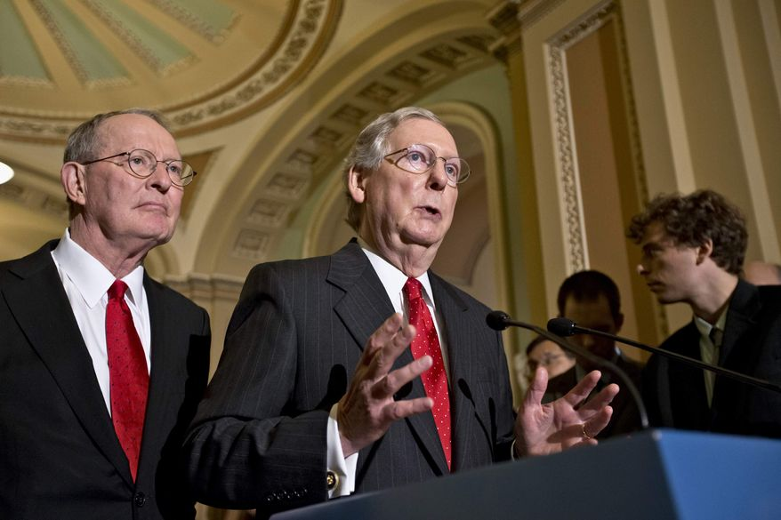 Senate Minority Leader Mitch McConnell of Ky. right, accompanied by Sen. Lamar Alexander, R-Tenn., gestures as he speaks with reporters on Capitol in Washington, Tuesday, July 9, 2013, about student loan rates following a Republican strategy session. Interest rates doubled to 6.8 percent last week because Congress didn't avert a rate hike built into the law. (AP Photo/J. Scott Applewhite)