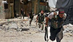 Syrian rebels run during heavy clashes with soldiers loyal to Syrian President Bashar Assad in the Salah al-Din neighborhood of Aleppo, Syria, on Tuesday, July 9, 2013, in this citizen journalism image authenticated by its contents and other AP reporting. Syria is entering its third year of a war that began as an uprising against Mr. Assad's rule. (AP Photo/Aleppo Media Center)