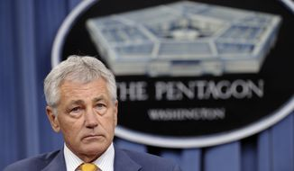 **FILE** Defense Secretary Chuck Hagel listens during a news conference at the Pentagon on June 26, 2013. (Associated Press)