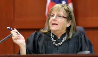 Judge Debra Nelson asks attorneys to project an animation image while listening to testimony from forensics animation expert Daniel Shoemaker during George Zimmerman's trial in Seminole Circuit Court in Sanford, Fla., on Tuesday, July 9, 2013. Mr. Zimmerman is charged with second-degree murder in the fatal shooting of Trayvon Martin, an unarmed teen, in 2012. (AP Photo/Orlando Sentinel, Joe Burbank, Pool)