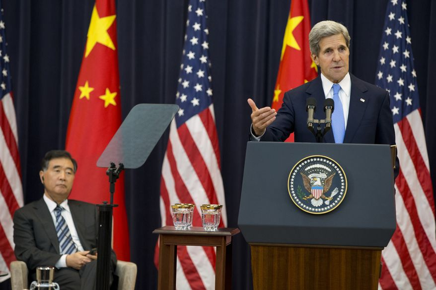 Chinese Vice Premier Wang Yang listens at left as Secretary of State John Kerry speaks during the opening session of the 2013 Strategic and Economic Dialogue on July 10, 2013, at the State Department in Washington. (Associated Press)