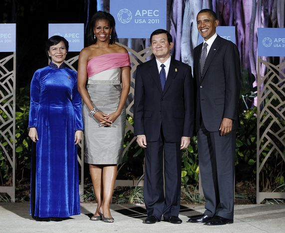 **FILE** President Obama and first lady Michelle Obama greet Vietnamese President Truong Tan Sang and wife Mai Thi Hanh before the APEC leaders dinner in Honolulu on Nov. 12, 2011. (Associated Press)