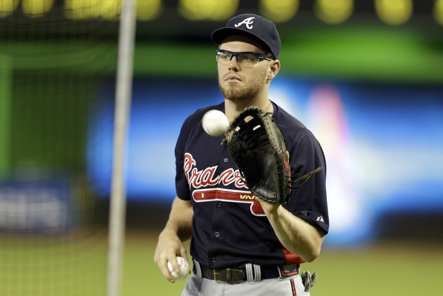 Atlanta Braves first baseman Freddie Freeman catches the ball during batting practice before a baseball game against the Miami Marlins, Tuesday, July 9, 2013 in Miami. (AP Photo/Lynne Sladky)