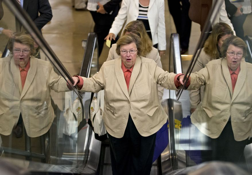 Senate Appropriations Committee Chair Sen. Barbara Mikulski, D-Md., rides an escalator in Washington, Wednesday, July 10, 2013, as senators rushed to the floor for a vote to end debate on the Democrats' plan to restore lower interest rates on student loans one week after Congress' inaction caused those rates to double. (AP Photo/J. Scott Applewhite)