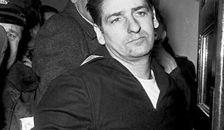 ** FILE ** This Feb. 25, 1967, file photo shows self-confessed Boston Strangler Albert DeSalvo minutes after his capture in Boston. (AP Photo, File)