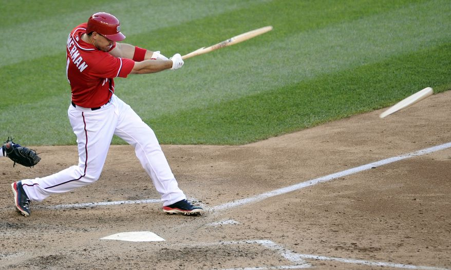 Washington Nationals' Ryan Zimmerman breaks his bat on an RBI single against the San Diego Padres during the seventh inning of the Nationals' 5-4 win on July 6, 2013. (Associated Press)