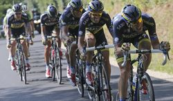 Team Saxo-Tinkoff with Spain's Alberto Contador in second position leads the breakaway taking over one minute on overall leader Christopher Froome of Britain during the thirteenth stage of the Tour de France cycling race over 173 kilometers (108.1 miles) with start in in Tours and finish in Saint-Amand-Montrond, western France, Friday July 12 2013. (AP Photo/Christophe Ena)