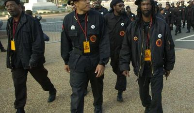** FILE ** Members of the New Black Panther Party walk toward the U.S. Capitol for the Million More Movement rally to commemorate the 10th anniversary of the Million Man March on Oct. 15, 2005. (J.M. Eddins Jr./The Washington Times)