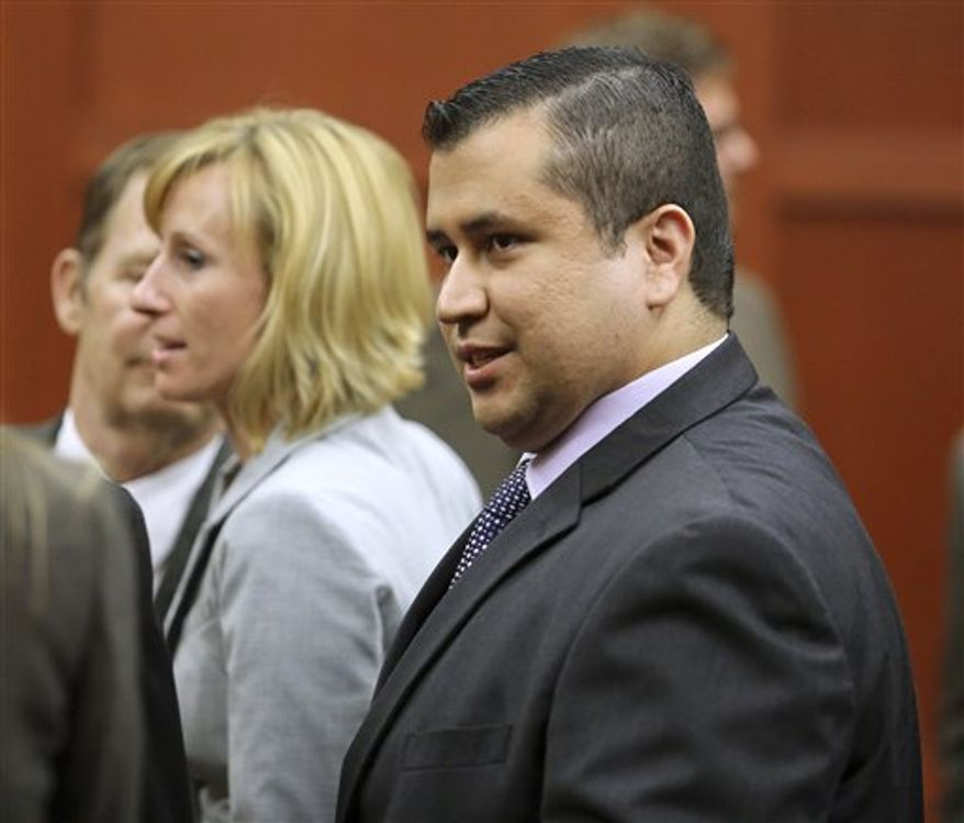 ** FILE ** George Zimmerman leaves court with his family after Zimmerman's not guilty verdict was read in Seminole Circuit Court in Sanford, Fla. on Saturday, July 13, 2013. Jurors found Zimmerman not guilty of second-degree murder in the fatal shooting of 17-year-old Trayvon Martin in Sanford, Fla. (Associated Press)