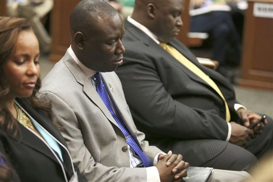 ** FILE ** Attorneys Natalie Jackson, Benjamin Crump, and Daryl Parks, from left, sit in for the Trayvon Martin family during George Zimmerman's trial in Seminole circuit court in Sanford, Fla. on Saturday, July 13, 2013. Jurors found Zimmerman not guilty of second-degree murder in the fatal shooting of 17-year-old Trayvon in Sanford, Fla. The six-member, all-woman jury deliberated for more than 15 hours over two days before reaching their decision. (AP Photo/Gary W. Green, Pool)