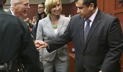 George Zimmerman, right, is congratulated by his defense team after being found not guilty during Zimmerman's trial in Seminole circuit court in Sanford, Fla. on Saturday, July 13, 2013. Jurors found Zimmerman not guilty of second-degree murder in the fatal shooting of 17-year-old Martin in Sanford, Fla. The six-member, all-woman jury deliberated for more than 15 hours over two days before reaching their decision Saturday night. (AP Photo/Gary W. Green, Pool)