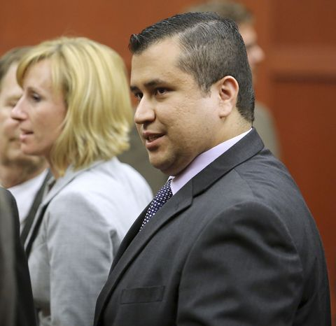 George Zimmerman leaves Seminole Circuit Court with his family on Saturday, July 13, 2013, in Sanford, Fla., after a jury found him not guilty of second-degree murder in the fatal shooting of