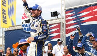 Brian Vickers celebrates in Victory Lane after winning the NASCAR Sprint Cup Series auto race at New Hampshire Motor Speedway in Loudon, N.H., Sunday, July 14, 2013. (AP Photo/Cheryl Senter)